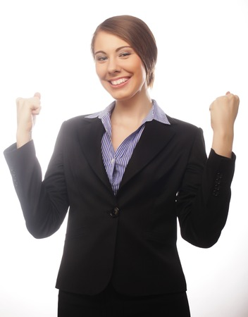 Winner business woman with her hands raised isolated on white