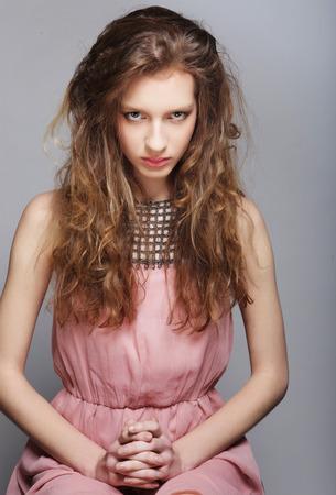 summer dress: beautiful young woman in a summer dress.
