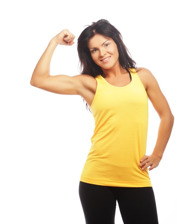 Cheerfully smiling  sporty woman demonstrating biceps Stock Photo