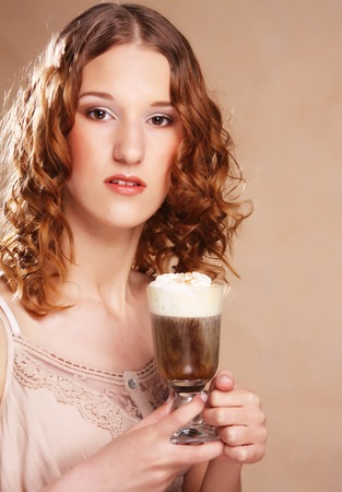 steam mouth: girl with glass of coffee witn cream