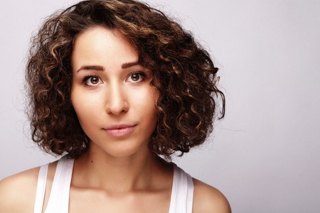 lifestyle and people concept:Young happy woman with curly hair Stock Photo