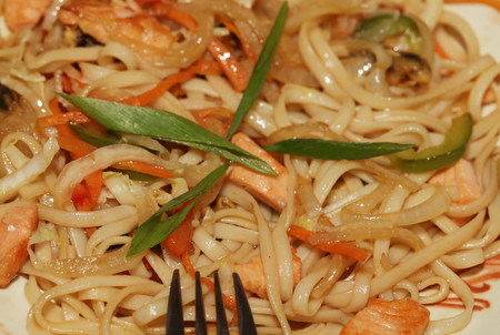 Chinese noodles on a white plate