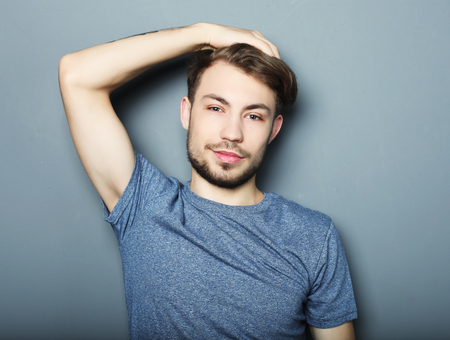 to contemplate: Portrait of sexy man over grey background Stock Photo