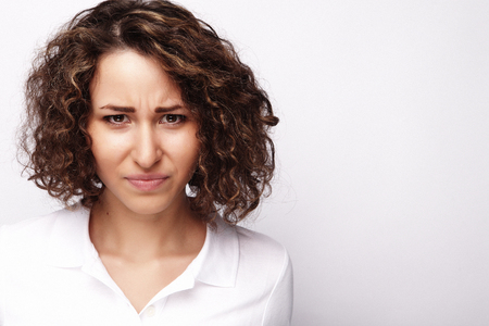 Portrait of dissatisfied young woman Stock Photo