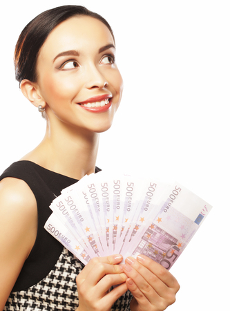 Young happy woman with dollars in hand. Isolated on white backgr Stock Photo
