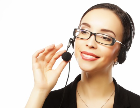 Portrait of smiling customer support female phone worker, over w Stock Photo