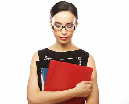 Portrait of happy young business woman with folders Stock Photo
