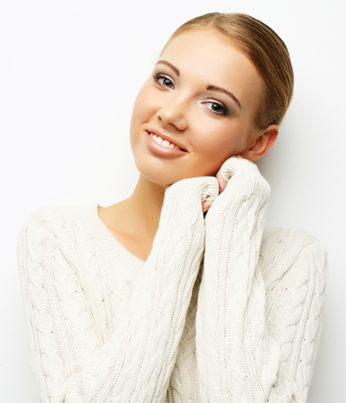 beautiful blonde girl on white background close-up