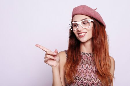 lifestyle, beauty and people concept: Beauty redhair girl  wearing pink beret 스톡 콘텐츠