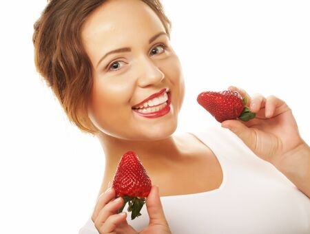 young happy woman with strawberry on the white background