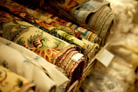 Sale - colorful fabrics in the store, close up, shopping concept