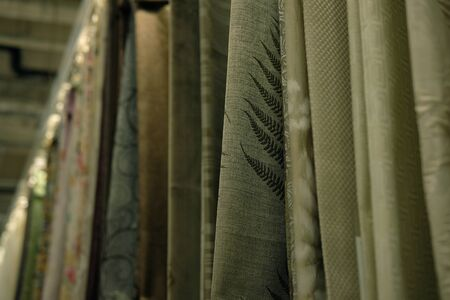 Rolls of fabric and textiles in store Stok Fotoğraf - 129822336