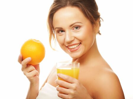 Healthy eating, food and diet concept -girl drinking orange juice