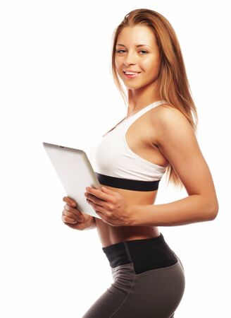 Smiling sporty woman with blank tablet computer over white background