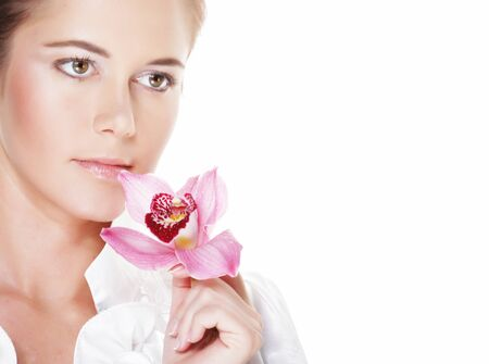 Beautiful young woman with pink flower over white background, close up Banque d'images - 129827054
