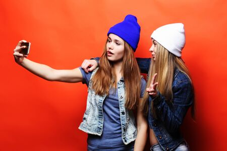 two young hipster girls friends  taking selfie Фото со стока