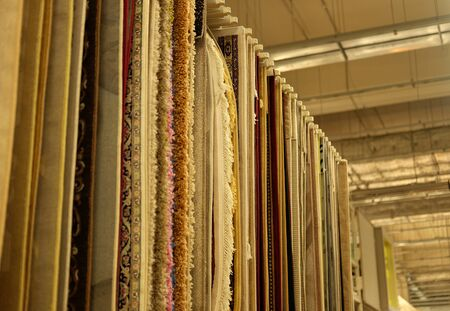 Sale! Assortment of different carpets in store. close up pictrure