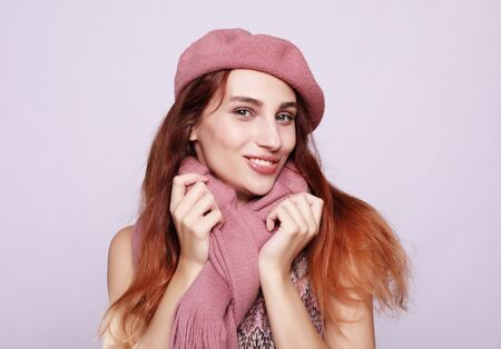 lifestyle, beauty and people concept: Beauty redhair girl  wearing pink beret, close up