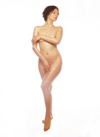 naked woman poses, isolated on a white background