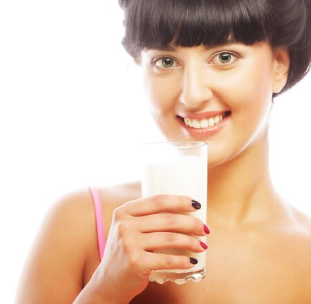 happy young woman with muesli and glass of milk