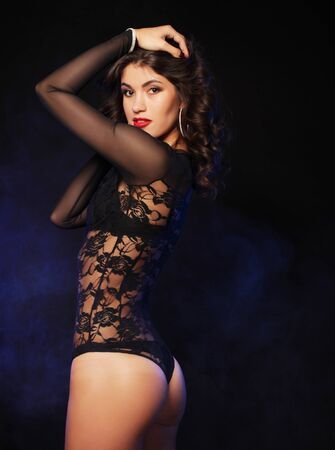 young striptease dancer over dark background, love and passion Banque d'images