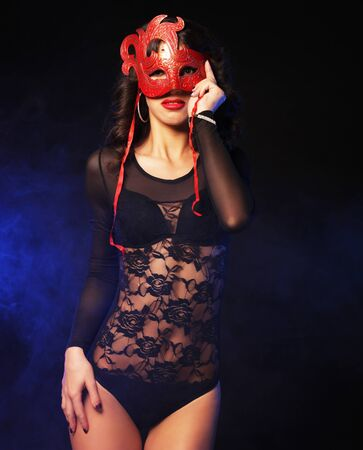 young striptease dancer with red mask Banque d'images