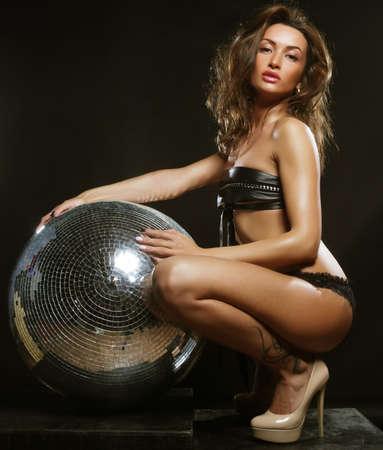 girl with disco ball Foto de archivo