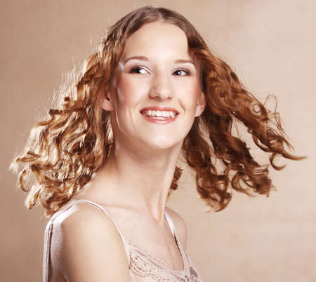 Image of beautiful young woman with curly hair 免版税图像