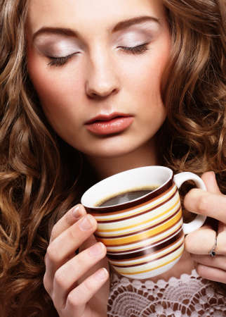 Portrait of young blond woman holding cafe cup close up Stock Photo