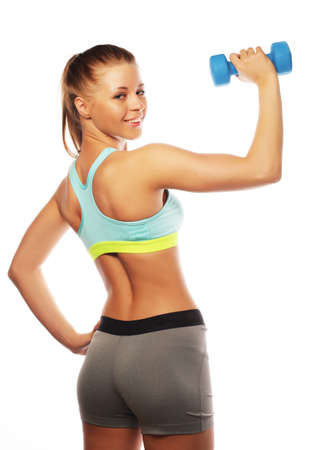 Woman in sport equipment practice with hand weights on white background