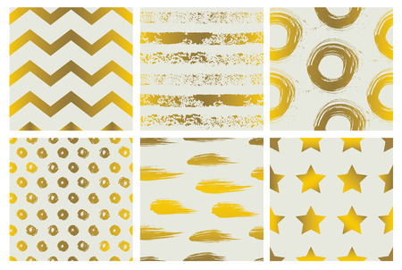 spectacular: Set of spectacular patterns with gold hand drawn elements on light background.