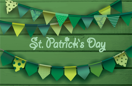 St. patricks day card. Colorful paper garlands on green wooden background. Vector illustration.