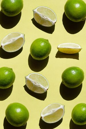 Limes on yellow background. Antioxidant Food.