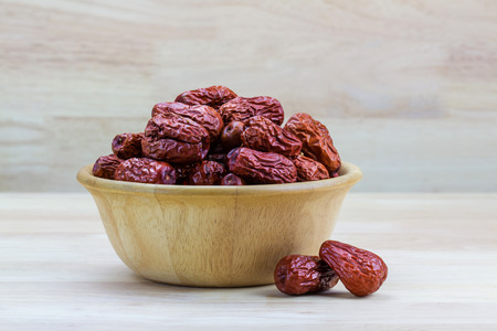 fruitage: Dried red jujube on wooden background