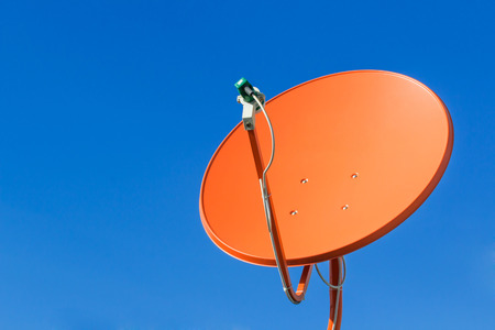 microwave antenna: Satellite dish  on background blue sky