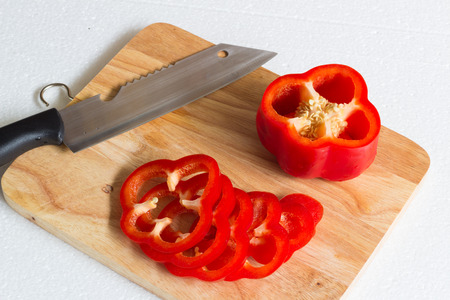 pimiento: Red sweet pepper on a chopping board.