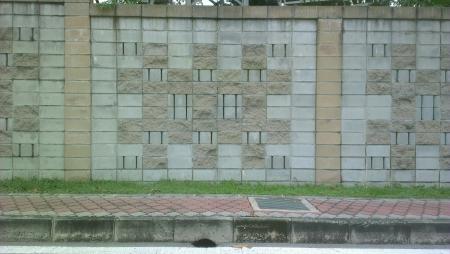 beside: Wall beside the road