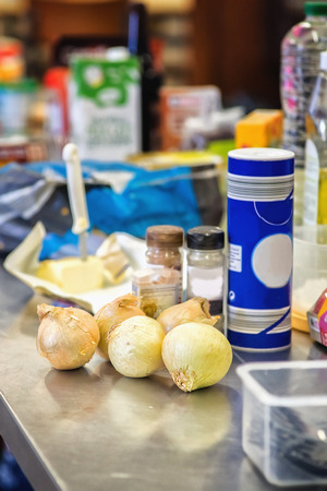 Onions and other food on a table. Close view. Stockfoto