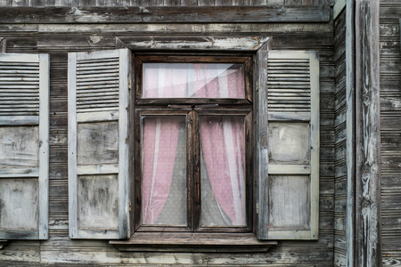 Old house window with shutters. close view. Stockfoto