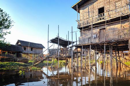 Bamboo houses on piles standing in water in township. Myanmar. Stockfoto