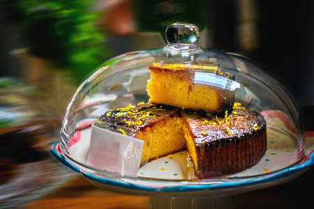 Lemon drizzle cake on a plate. Close up.