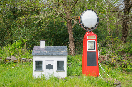 Old refueling column and small house. ireland.