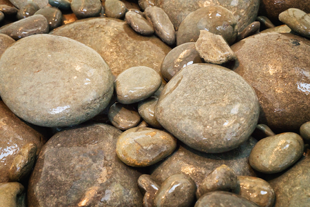 Many various size wet  stones. Close up.