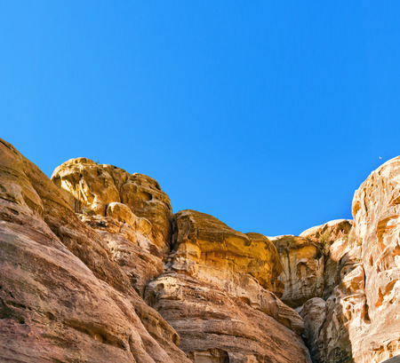 Rocks in mountains of Petra on sunny day. Jordan.