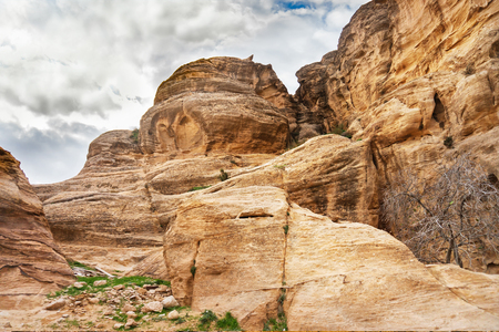 Rocks in mountains of Petra on cloudy day. Jordan.