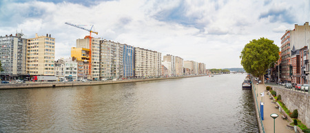 Panoramic view of Meuse rivers quays and ships to their. Liege, Belgium.