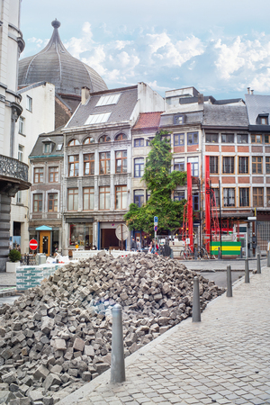 Paving works on the street of the old town of Liege.A  large pile of paving stones. Belgium