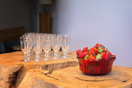 Ripe strawberries  and glasses on a wooden table. Stockfoto