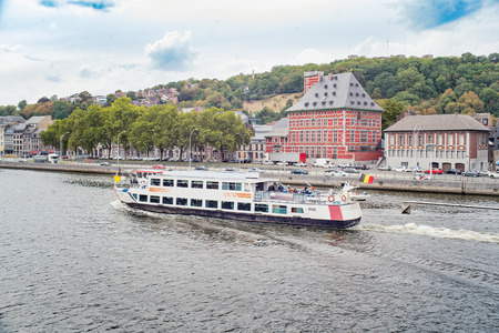 Ship with tourists in a river Meuse. Liege, Belgium.