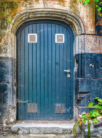 Old blue wooden door in an old house. Liege, Belgium